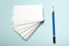 Business card blank over office table. Corporate stationery branding mock-up Royalty Free Stock Photo