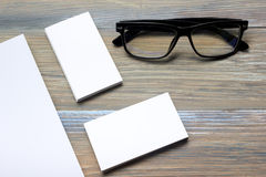 Business card blank over office table. Corporate stationery branding mock-up Royalty Free Stock Image