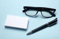 Business card blank over office table. Corporate stationery branding mock-up Royalty Free Stock Photography