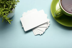 Business card blank over office table. Corporate stationery branding mock-up Stock Photo