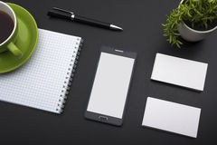 Business card blank, smartphone or tablet pc, flower and pen at office desk table top view. Corporate stationery. Branding mock-up Royalty Free Stock Photos