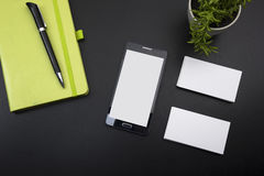 Business card blank, smartphone or tablet pc, flower and pen at office desk table top view. Corporate stationery. Branding mock-up Stock Photo