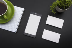 Business card blank, smartphone or tablet pc, flower and pen at office desk table top view. Corporate stationery. Branding mock-up Royalty Free Stock Image