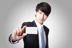 Business card in business man hand Royalty Free Stock Photos