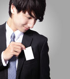 Business card in business man suit pocket Stock Photo