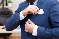Business card. Businessman put card in business suit. Man. Modern businessman. Male fashion. Man with credit card. take. Out copy space in pocket. Here is my royalty free stock images