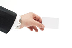 Business card in businessman's hand Stock Image