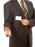 Business card in businessman's hand. With another hand ready for handshake Stock Images