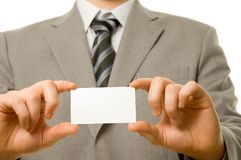Business card in businessman's hands Royalty Free Stock Photos