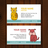 Business card with cat and dog for veterinary clinics on wooden Stock Photos