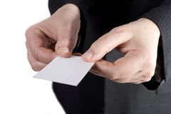 Business card the Chinese way. A businessman giving a card the Chinese way (with two hands stock images