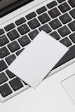 Business card on computer Stock Image