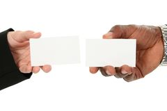 Business Card Exchange. Caucasian female and African American male hands exchanging business cards. Add text royalty free stock image