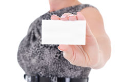 Business card in female hand isolated Stock Image