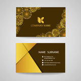 Business card - Gold floral frame on brown background vector design Stock Photos