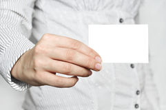 Business card in hand Stock Photos
