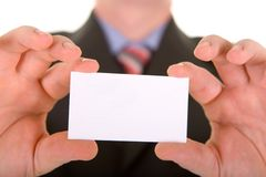 Business card in a hand Royalty Free Stock Photo