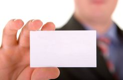Business card in a hand Stock Image