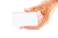 Business card in hand. Blank white business card in a hand Royalty Free Stock Photography