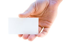 Business card in hand. Blank white business card in a hand Royalty Free Stock Photo