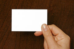 Business card  at the hand of a woman Stock Photo