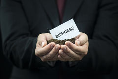Business card in hands on the ground Royalty Free Stock Image