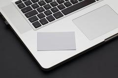 Buisness card on keyboard Royalty Free Stock Photos