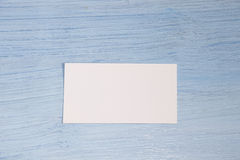 A business card lies in the center on a blue background Royalty Free Stock Image