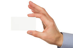 Business card in male hand Stock Photos