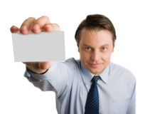 Business card in male's hand. Business card in the hand of smiling businessman Royalty Free Stock Images