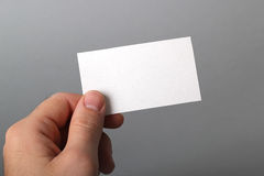Business card. A man holding a business card Stock Photos