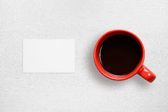Business card mock-up and coffee cup Stock Images