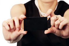 Business card presented by stylish lady Royalty Free Stock Photography