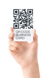 Business card with QR code data isolated. Hand showing business card with QR code data information. Isolated on white Royalty Free Stock Photos