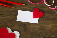 Business card with a red heart , pens and tape Stock Image