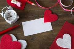 Business card with a red heart, watches Stock Photos