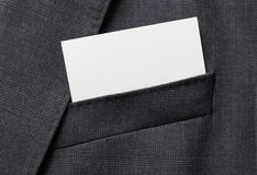 Business card in suit pocket Stock Images