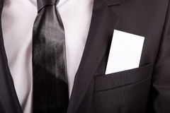 Business card in suit's pocket Stock Images