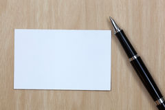 Business card. On table with pen Royalty Free Stock Photos