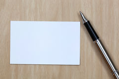 Business card. On table with pen Royalty Free Stock Photo