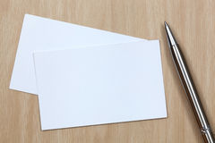 Business card. On table with pen Royalty Free Stock Images