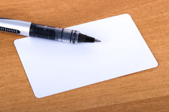 Business Card Template. Blank business card with pen mock up on wood background stock photos