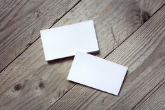Business card template for branding identity. On wood background royalty free stock photo