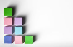 Business card template. Empty colorful paper cubes in a row on white background. copy space available stock photography