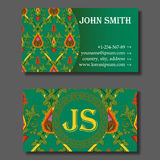 Business card template green and orange vintage pattern. Business card template, green and orange vintage pattern with ivy, leafs and fire flowers. Vector Stock Photo