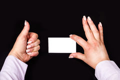 Business card template in the hands of Stock Images
