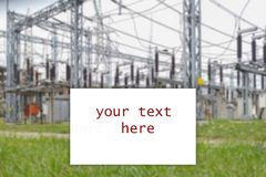 Business card template linked with electricity industry. Electrical distribution station, transformers, high-voltage lines,. Electricity in background royalty free stock photography