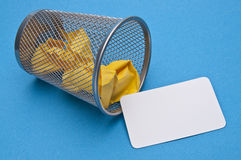 Business Card Tossed in the Trash Stock Photos