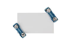 Business card with two straps jeans with rhinestones, isolated on a white background Royalty Free Stock Photo