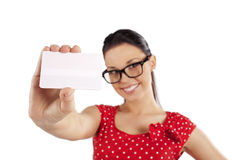 Business card white. Smiling young woman in red dress showing a card . focus in the business card Stock Photos